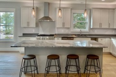 River Blue hard marble island with MSI Q Quartz Mirano Gray for the perimeter in Piney Point, MD