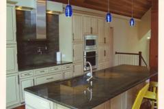 Full height splash with pot filler faucet.