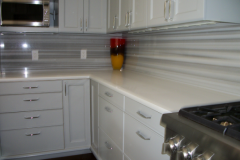Striated marble kitchen countertops with full height splash in Waldorf.