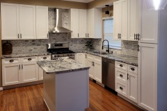 Kitchen with island in Viscont White granite. Southern MD remodel.