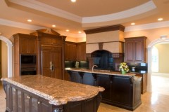 Two layer thick island with ogee edge in granite kitchen.