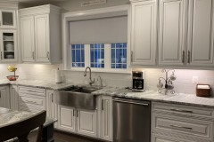 Fantasy Brown kitchen with apron front farm sink in Harwood, MD