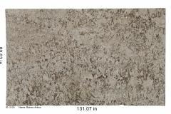 Bianco Antico granite. Cream colored bedrock with huge pieces of mica and bits of beige, tan and white consistently spread across entire stone.  Mid-range price.