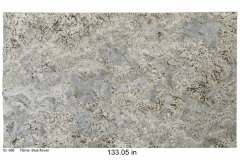 Blue Flower granite.  White base with light blue throughout and hints of gold and black. Looks great on white or wood cabinets.  Low price range.