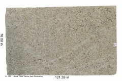Giallo Verona granite.   A coarse-grained, light brown-yellow stone with some brown-red garnets.  Has a consistent pattern that is very uniform.  Low price range.