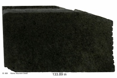 Mountain Green granite.  A lush forest green stone with various black and gray minerals and has a consistent pattern. Mid price range.