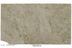Snow Fall granite. A cream colored bedrock with rich notes of gold and black specks, has some beautiful quarts deposits and flecks of mica.  Consignment price.