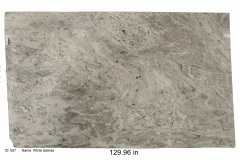 White Salinas granite.  A light beige stone with blue gray veining and lots of garnet.  Compliments white and gray cabinets the best.  Low price range.